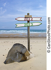 2012 2013 - Double directional signs on a beach 2012 to 2013