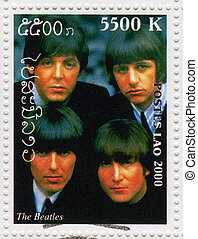 LAOS - CIRCA 2000 : stamp printed in Laos shows the Beatles...