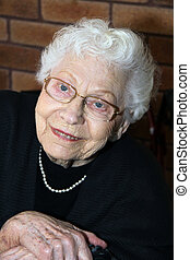 Pensive old Lady - Portrait shot of a smiling old lady with...