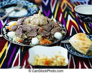 Uzbek pilaff served at table - Traditional Uzbekistan dish -...
