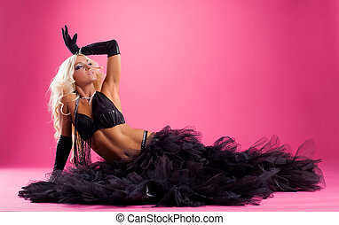 middle age blond woman lay in black arabic costume