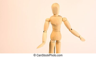 Doll-dummy move hands and incline body on white background,...