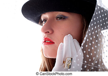 blonde in retro style with vail, hat, and gloves with ring