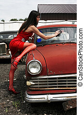 girl washing vintage car