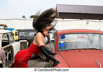 girl beside retro car with flapping hairs