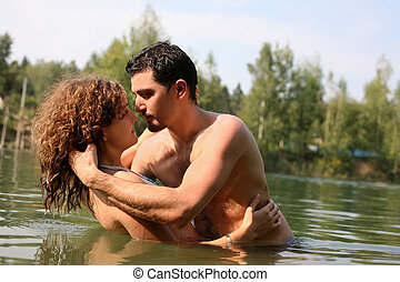 romantic couple in water