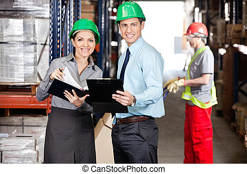 Supervisors Working At Warehouse