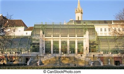 People walk in Palmenhaus which stands in Hofburg Palace...