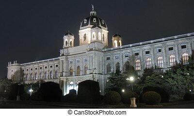 People walk in front of Natural Museum when in evening -...