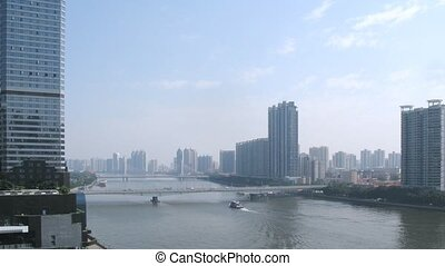 Cars go on afternoon on Jiangwan Bridge and Haiyin Bridge in front of cityscape