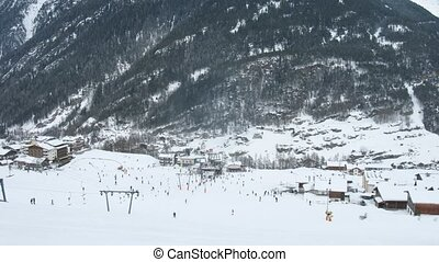 Tourists go on ski and snowboard on ski slope - SOELDEN -...