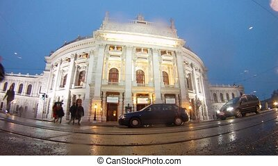 Cars go near to Burgtheater in rain - VIENNA - FEB 19:...