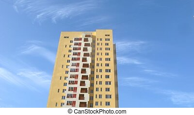 Blue sky roof high-rise building of yellow color, time lapse