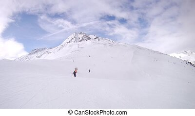 Tourists go on skis on mountain Tiefenbach downwards -...