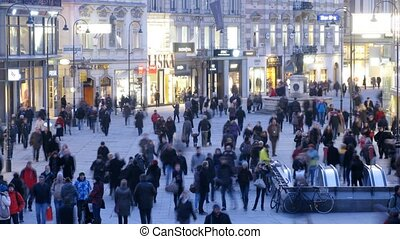 Tourists walk on Graben street near Saint Leopold fountain -...