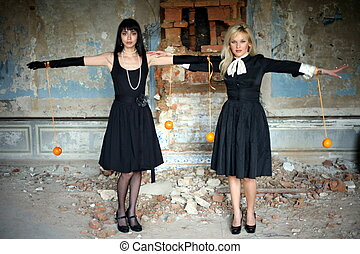 two girl with oranges inside vintage house