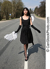 angel in the road with broken wing