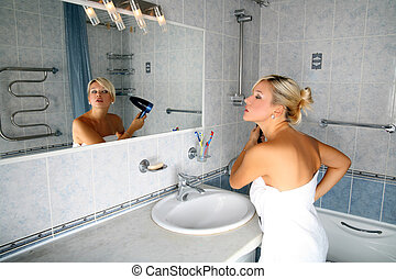 girl in bathroom with drier
