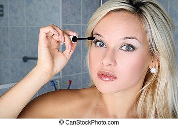 girl in bathroom with liquid mascara
