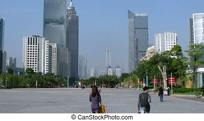 People walk along street Zhujiang New Town - GUANGZHOU - NOV...
