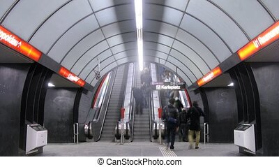 People go on escalator to subway - VIENNA - FEB 22:...