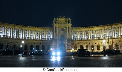 Imperial Palace and historic museum Hofburg stands at night,...