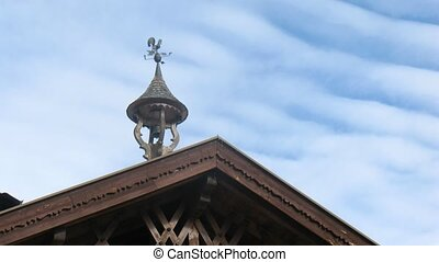 House roof is decorated by ahand bell and compass with cock,...