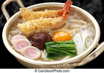 steaming nabeyaki udon, japanese ho - nabeyaki udon, a sort...