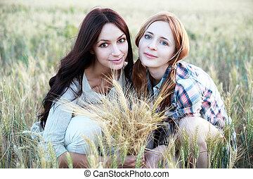 Two girls in field