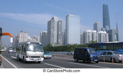 Cars go on highway between crossroads and Zhujiang New Town...