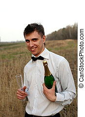young man with a glass and bottle of wine