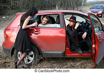 brunette , man and woman with cigar, wine in car