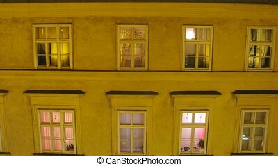 In house windows of house switch on and off light, time...