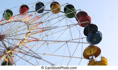 Observation wheel fly round and shine by multi-colored light...