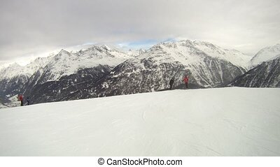 Skiers go on ski slope mountains Tiefenbach - SOELDEN - FEB...
