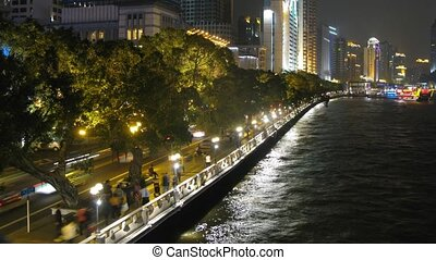Cars and people go along on embankment of Pearl river at night