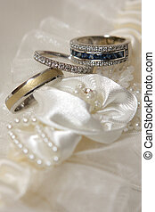 Three Rings - Three diamond wedding rings on material...