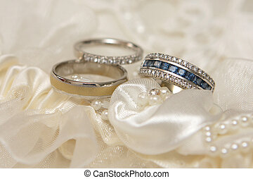 Wed Rings - Three wedding rings with diamonds and gems