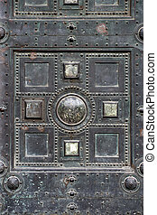 Gothic entrance - Section of an old metal gothic door.