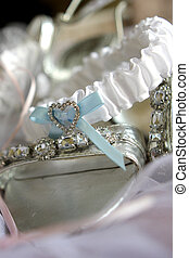 Shoe Garter - A brides silver shoes and white garter