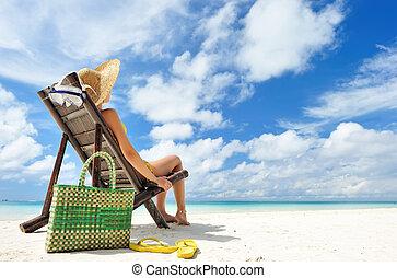 Girl on a beach - Girl on a tropical beach with hat