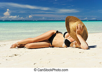 Girl on a beach - Girl on a tropical beach with hat