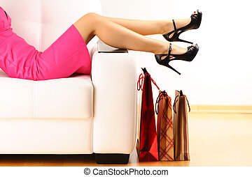 Woman with shopping bags - Woman's legs and shopping bags