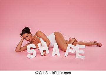 Beautiful shapely woman with the word SHAPE - Beautiful...