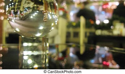 Bar counter of New Year cafe is reflected in transparent...