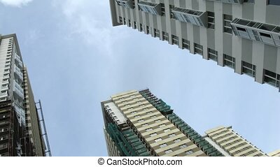 Many new buildings aspire upwards to sky, time lapse