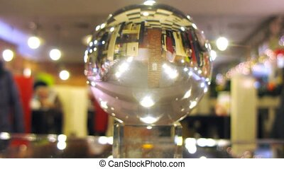 New Year cafe is reflected in transparent ball