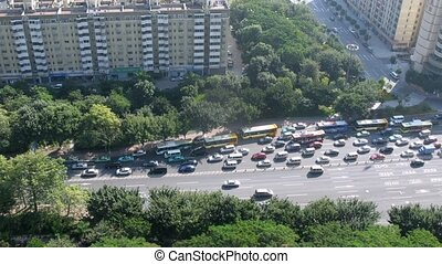 Cars quickly go on road which is narrowed down, time lapse
