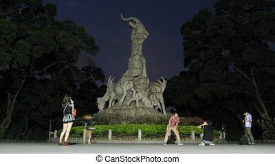Tourists are photograph near to Sculpture of Five Rams in...