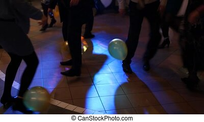 In disco people burst balloons adhered to their feet